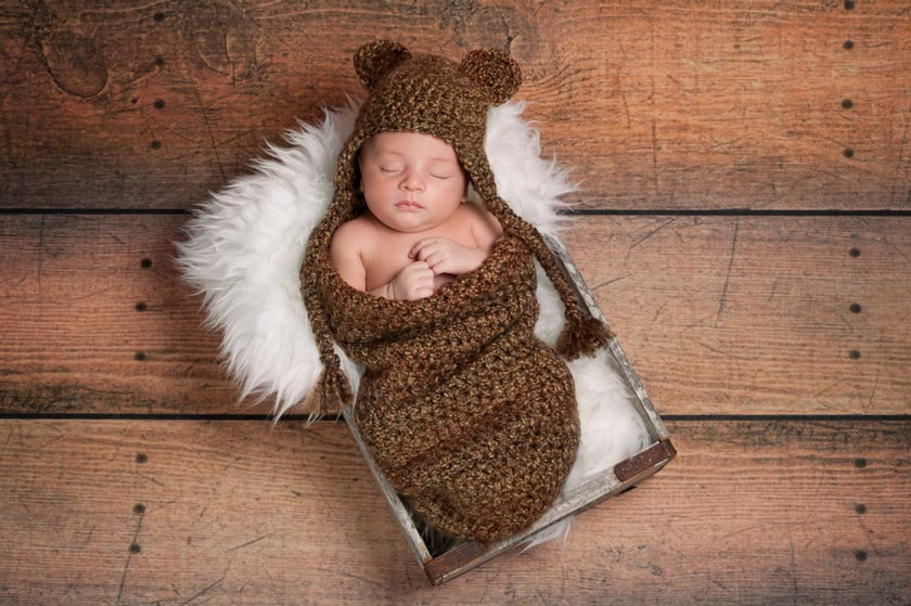 Babyschlafsack Test - Baby schläft in einem süßen Schlafsack